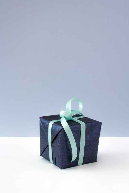 blue gift box with blue ribbon