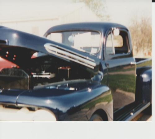 Old car show, black pickup truck