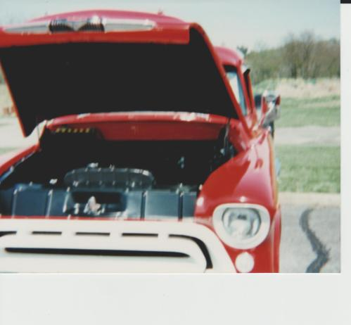 Old car show, red pickup truck
